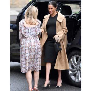 Meghan Markle stepping out of car wearing a khaki-colored Zeagoo Open Front Trench Coat and stylish Nom Maternity 'Hailey' Maternity Dress