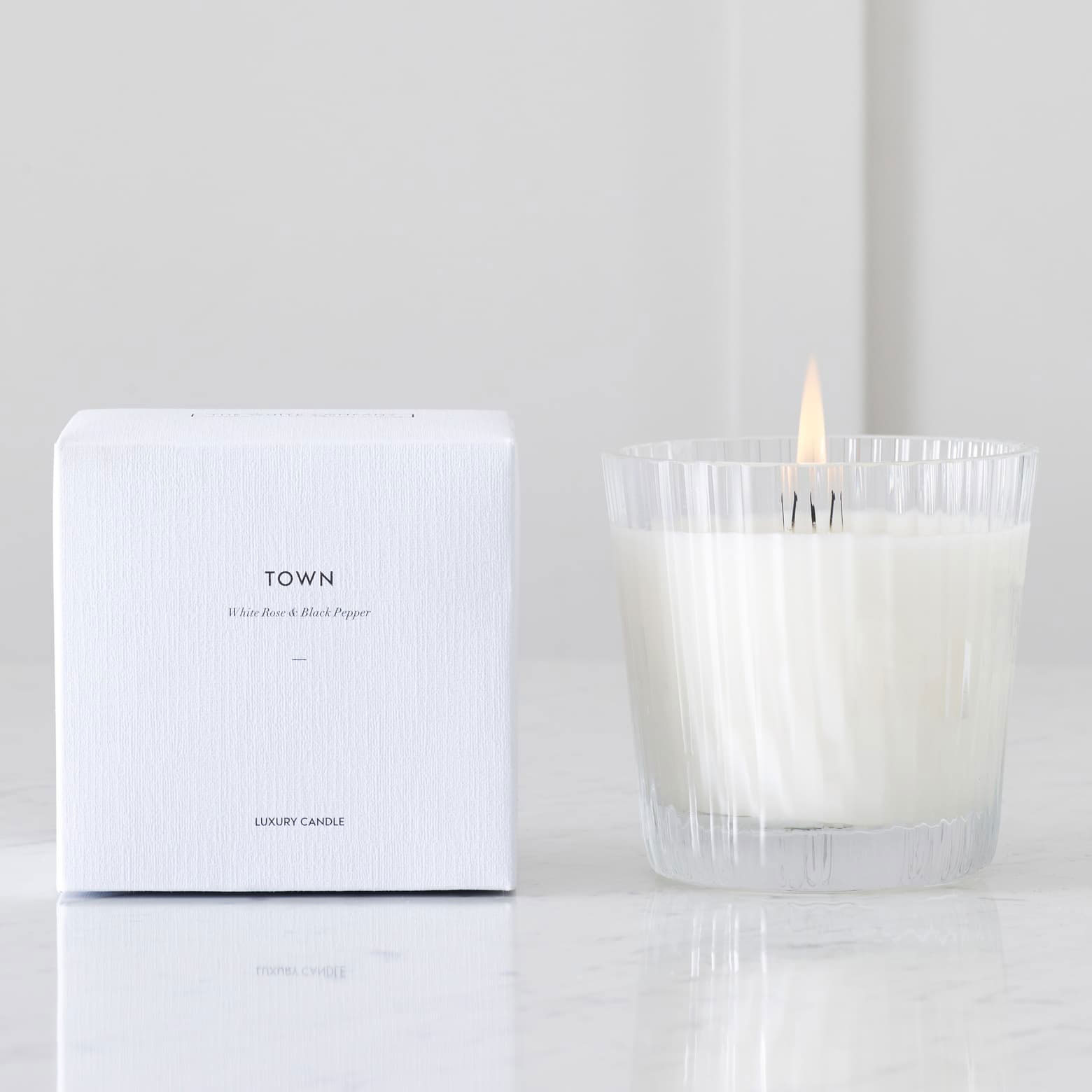 The White Company Ceramic Candle in White Rose and Spicy Black Pepper