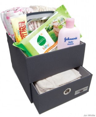 The JJ Cole Collections diaper and wipes caddy